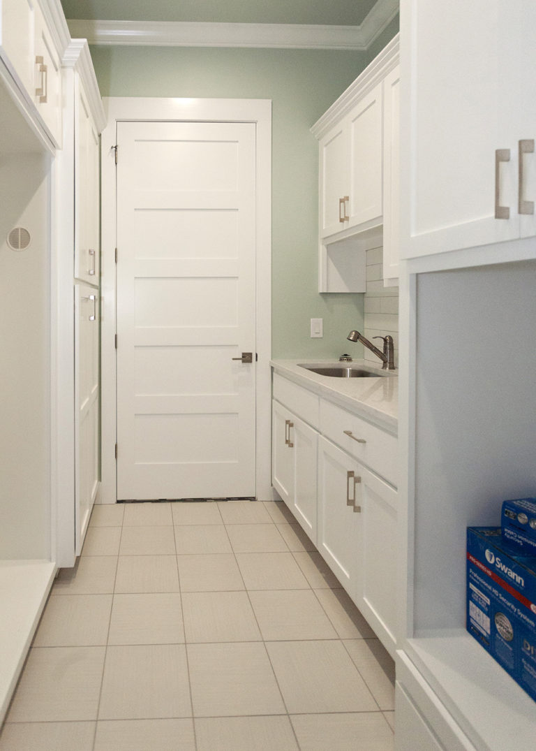 Reidy Modern Style Home Laundry Room With Built in Cabinets and sink
