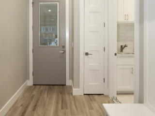Reidy Modern Style Home Mudroom with storage closet