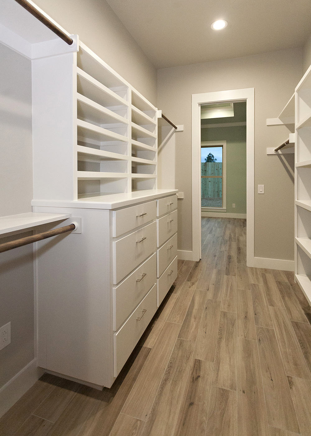 Reidy Modern Style Home Master Walkthrough Closet with built in cabinets and shelving